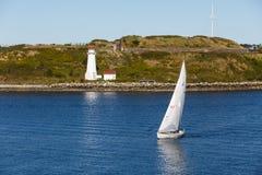 White Sailboat by White Lighthouse Stock Photos