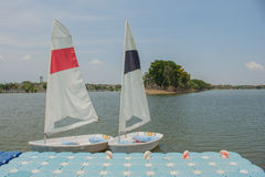White sailboats dock on lake. Royalty Free Stock Photography