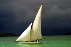 White sailed pirogue on the ocean Royalty Free Stock Photos