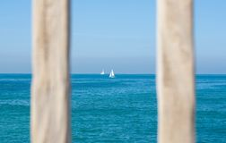 White Sailing Boat on Body of Water Stock Images