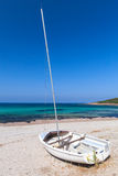 White sailing boat lays on the beach, Corsica Royalty Free Stock Photography