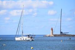 White sailing boat leaving the harbor of Port Andratx Stock Image