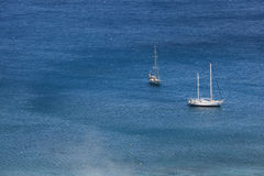 White sailing boats in blue sea, aerial view. Royalty Free Stock Image