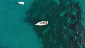 White sailing yacht with solar panels on the deck. against the background of the turquoise ocean. The concept of. Expensive relaxation and environmental stock video footage