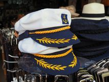 White Sailors Hat at Greek Tourist Shop. White nautical captains sailors caps or hats, for sale at a Greek souvenir shop, Skiathos, Greece Stock Photography