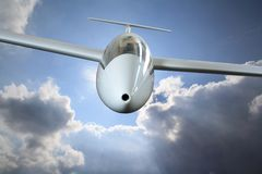 White sailplane flying through rain clouds Royalty Free Stock Photo