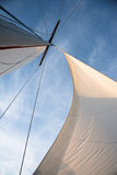 White sails against blue sky Stock Photography