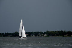 White Sails against Dark Stormy Sky Royalty Free Stock Image