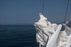 White sails on bowsprit sailboat blue sky background Royalty Free Stock Images