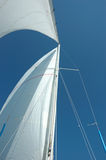 White sails and mast and the blue sky Royalty Free Stock Images