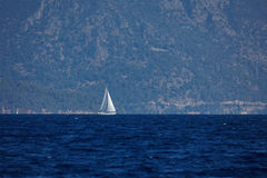 The white sails of yachts on the background of sea and mountains Royalty Free Stock Photos