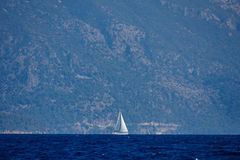 The white sails of yachts on the background of sea and mountains Royalty Free Stock Photo