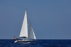 The white sails of yachts on the background of sea and sky Stock Photography
