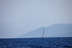 The white sails of yachts on the background of sea and sky Stock Photos