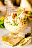 White salad in glass. Closeup of traditional white salad in glass with napkin and silver spoon on table stock photo