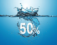 White sale fifty percent dropped into water with splash  on  blu Stock Images