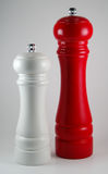 White salt mill and red pepper mill Royalty Free Stock Image