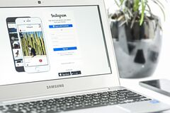 White Samsung Laptop Computer Showing Smartphones stock images