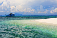 White sand beach. And a ship on a nice day in Mun Nork Island, Thailand Royalty Free Stock Photos