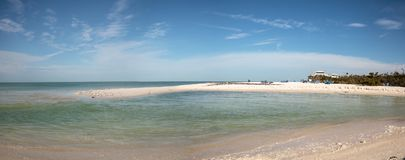 White sand beach and aqua blue water of Clam Pass in Naples, Flo. Rida in the morning Stock Images