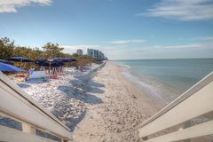 White sand beach and aqua blue water of Clam Pass in Naples, Flo. Rida in the morning Royalty Free Stock Image