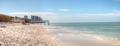 White sand beach and aqua blue water of Clam Pass in Naples, Flo. Rida in the morning Royalty Free Stock Photography