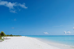 White sand beach and blue blue sky Royalty Free Stock Photo