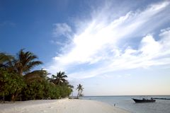 White sand beach and blue blue sky Stock Photography