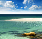 White sand beach with blue sea and clear water Stock Images