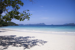 White sand beach, blue sea water.  Royalty Free Stock Images