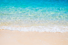 White sand beach and blue sea wave Stock Photography