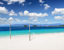 White sand beach and blue sky Stock Photos