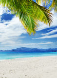 White sand beach and blue sky. Royalty Free Stock Photo