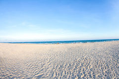 White sand beach and blue sky with people playing sea water,  ba Stock Photography