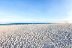 White sand beach and blue sky with people playing sea water,  ba Royalty Free Stock Images
