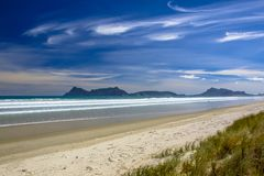 White Sand Beach With Blue Sky at Waipu in New Zealand Stock Image