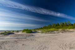 White sand beach with blue sky and white clouds. Stock Photo