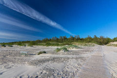 White sand beach with blue sky and white clouds. Royalty Free Stock Photography