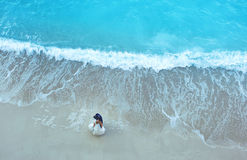 White sand beach and blue water with beautiful bride and groom lovely couple Stock Image