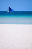White sand beach and boat Stock Images
