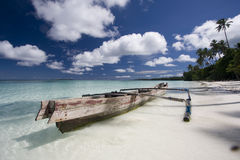 White sand beach with boat. Tropical landscape with a boat and white sand beach Stock Photos