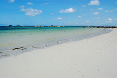 White sand beach, bretagne, france. View of the beach at medium tide typical of bretagne area in france picture taken in brignogan-plages, france royalty free stock photos