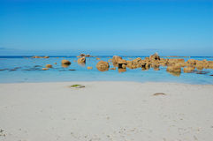 White sand beach, bretagne, france. View of the beach at medium tide typical of bretagne area in france picture taken in brignogan-plages, france stock images