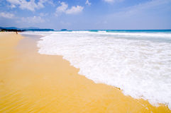 White sand beach clean and clear blue sky Stock Photo