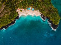 White sand beach with coconut palms and crystal blue ocean in Bali. Aerial view. White sand beach with coconut palms and crystal blue ocean in Bali royalty free stock images