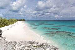 White sand beach with coral reef Royalty Free Stock Image