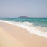 White sand beach on Fuerteventura. Canary islands; white sand beach on Fuerteventura (Corralejo Flag beach); small island Isla de Lobos in the background Stock Photography