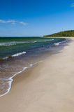 White sand beach and green water of Baltic sea Stock Photos