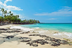 White sand beach on Hawaii Big Island with azure ocean in backgr Royalty Free Stock Image