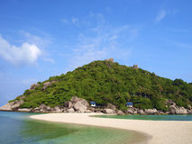 White sand beach and hill on island Stock Images